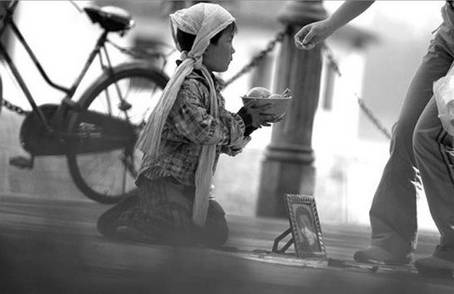 A kid on the street for money