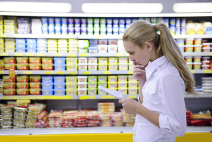 Woman using grocery shopping list