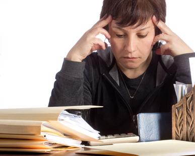 Woman overwhelmed by finances